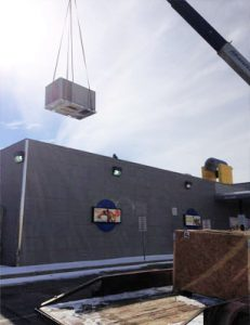 Rooftop HVAC unit beiong installed for a commercial client