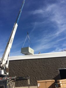 Commercial heating rooftop unit being installed by Westerhouse.